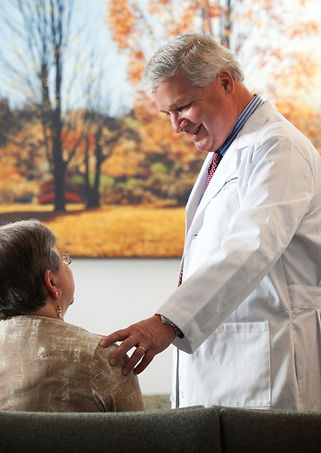 Internist, Dr. Robert Olson with patient