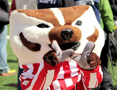 Bucky Badger holding up thumb and index finger to form a W.