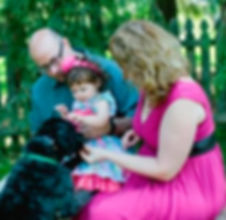 OB/GYN, Dr. Amanda Schmehil with her husband, daughter, and dog.