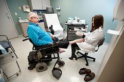 Podiatrist, Dr. Schroeder examining patient.