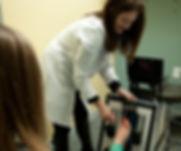 Podiatrist, Dr. Michelle Schroeder working with patient.