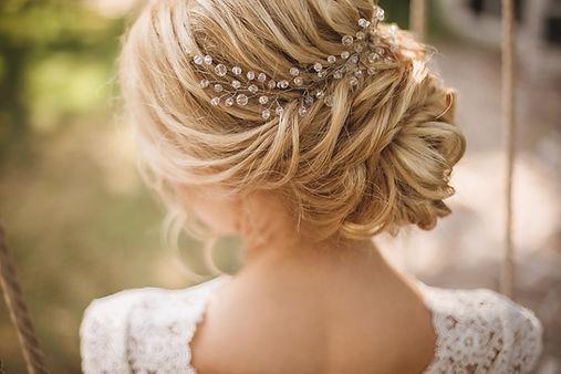 Hair do with an elegant bridal hair acce