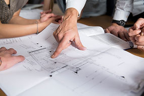 photo of people looking at plans