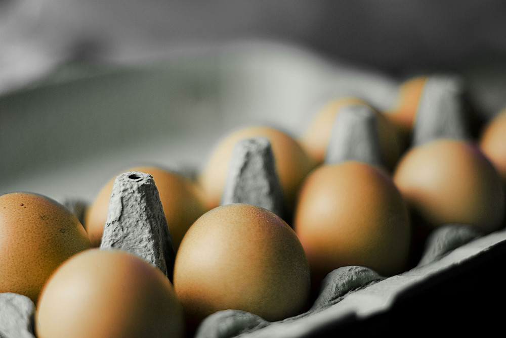 A carton of farm-raised eggs