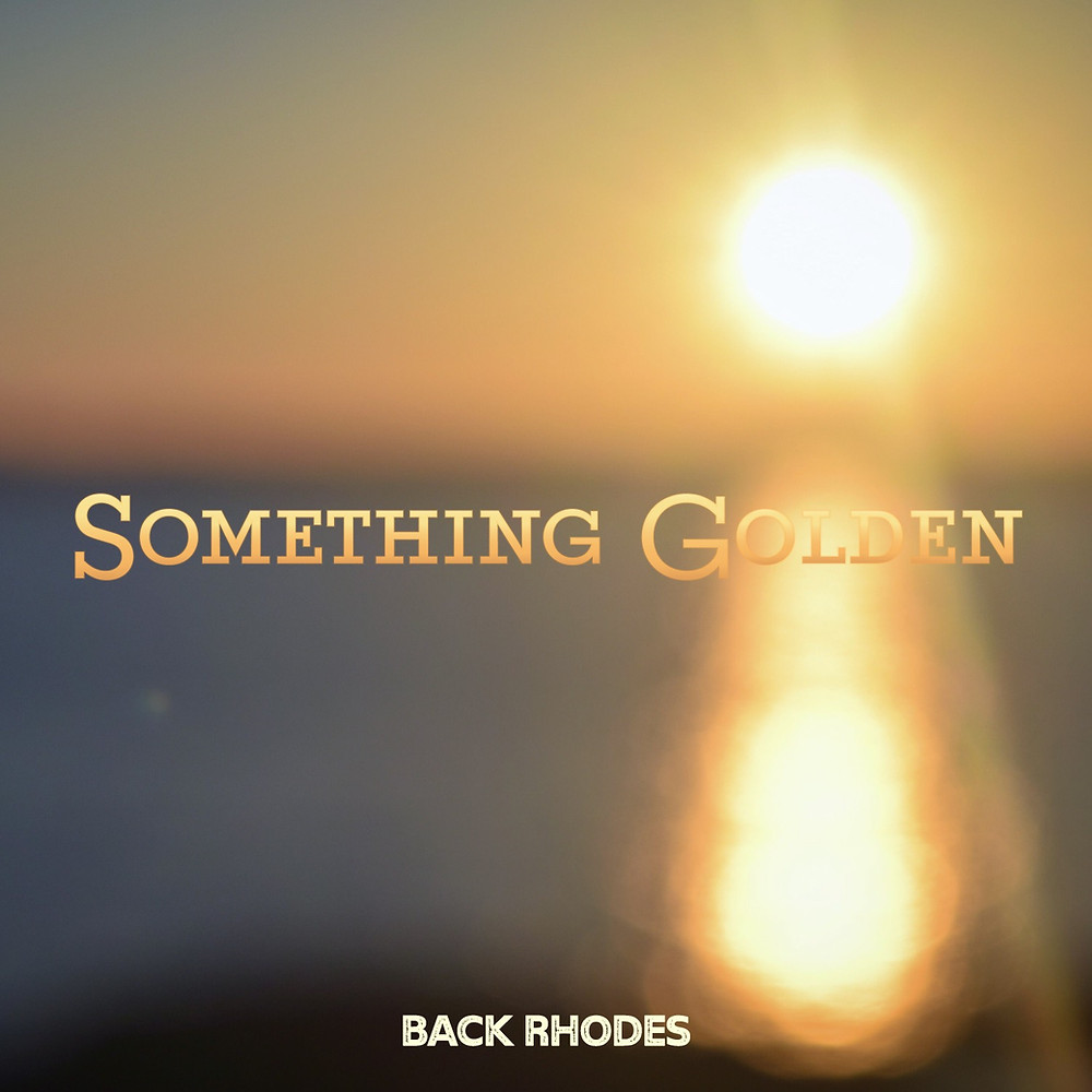 Text Something Golden is centered over a giant intense blurry sunset on the right side of the album cover. Text Back Rhodes appears smaller and is centered on the bottom of the image.