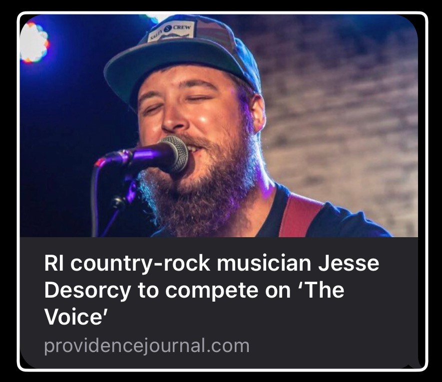 Jesse Desorcy on stage singing with text RI Country rock musician Jesse Desorcy to compete on The Voice
