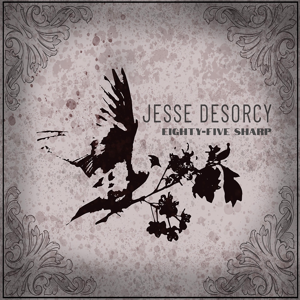 A silhouette of a dove is centered with text Jesse Desorcy, eighty-five sharp is in all caps below