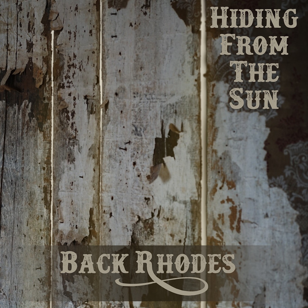 Album cover background of old grainy wood with light coming through the cracks. Text displays hiding from the sun in the top right corner. Text Back Rhodes is centered on the bottom.