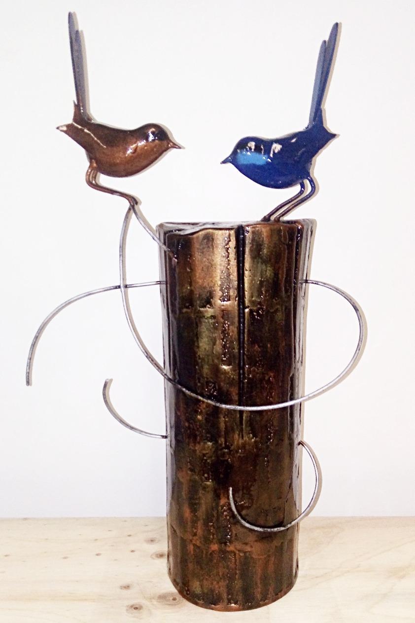 Birds on a post
