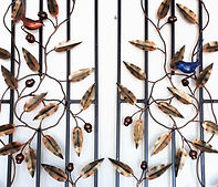 Blue wrens on eucalyptus wreath iron doors.  Male and female blue wrens made from recyced steel.
