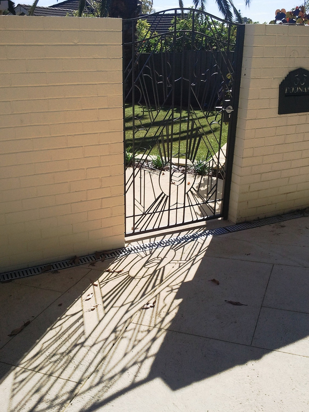Art Deco pedestrian gate to match stained glass front door work