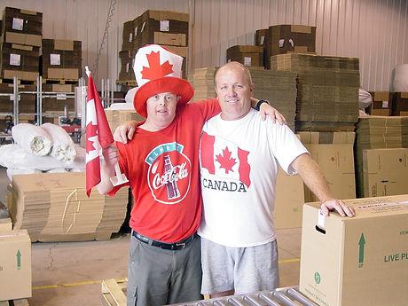 "alt=""Staff members in Canada Day attire"""