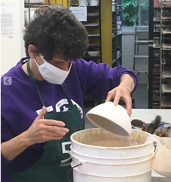 GLPG. Liz Meyers, glazing a pot.png