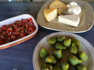 platter of cheese and figs