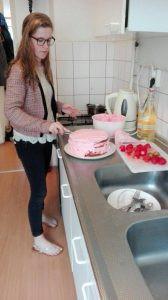 student preparing a cake