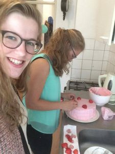 students preparing a cake together