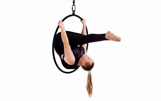 girl using lyra hoop upside down