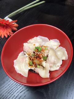 Pork Dumpling in Szechuan Chili Sauce