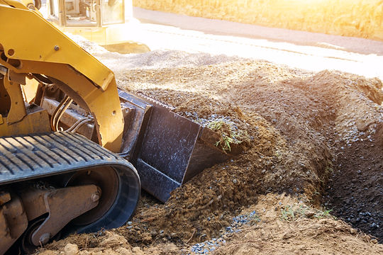 Mini bulldozer working with earth while