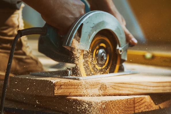 Close-up of a carpenter using a circular