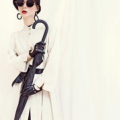 A lady wearing sunglasses.