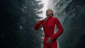 Bogner Fashion for Mytheresa. A young woman getting dressed in her red ski suit. Shot by Tjark Lienke.