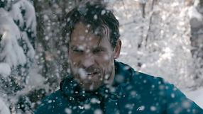 Man runs powerful through snow during winter. Shot by Tjark Lienke for BMW