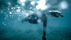 Iceswimmer strokes fiercefully underwater. Shot by Tjark Lienke for BMW.