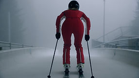 Young female on skies in a bobsleigh track. Shot by Tjark Lienke.