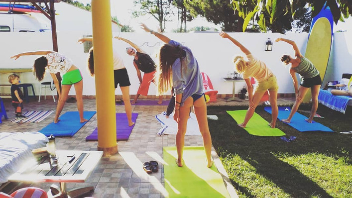 Yoga session in our pation after intensive surf session