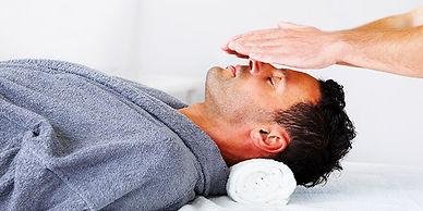 man-receiving-reiki-therapy-600x300.jpg