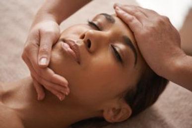 Facial-massage-Black-woman-flipped-300x2