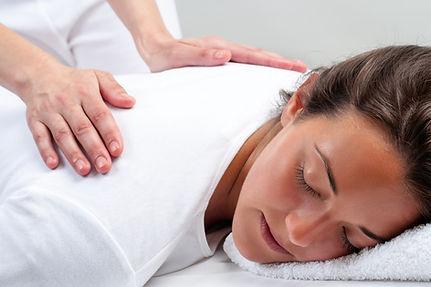Canva - Reiki therapist doing treatment