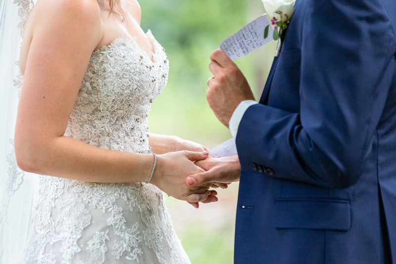 bride and groom exchanging letters during first look wedding photos in Calgary