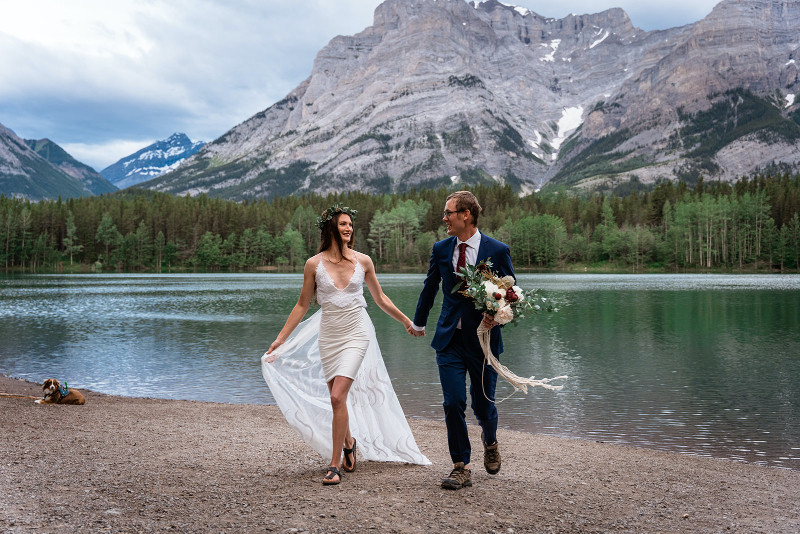 Bride and Groom Photos in front of lake in the Rocky Mountains