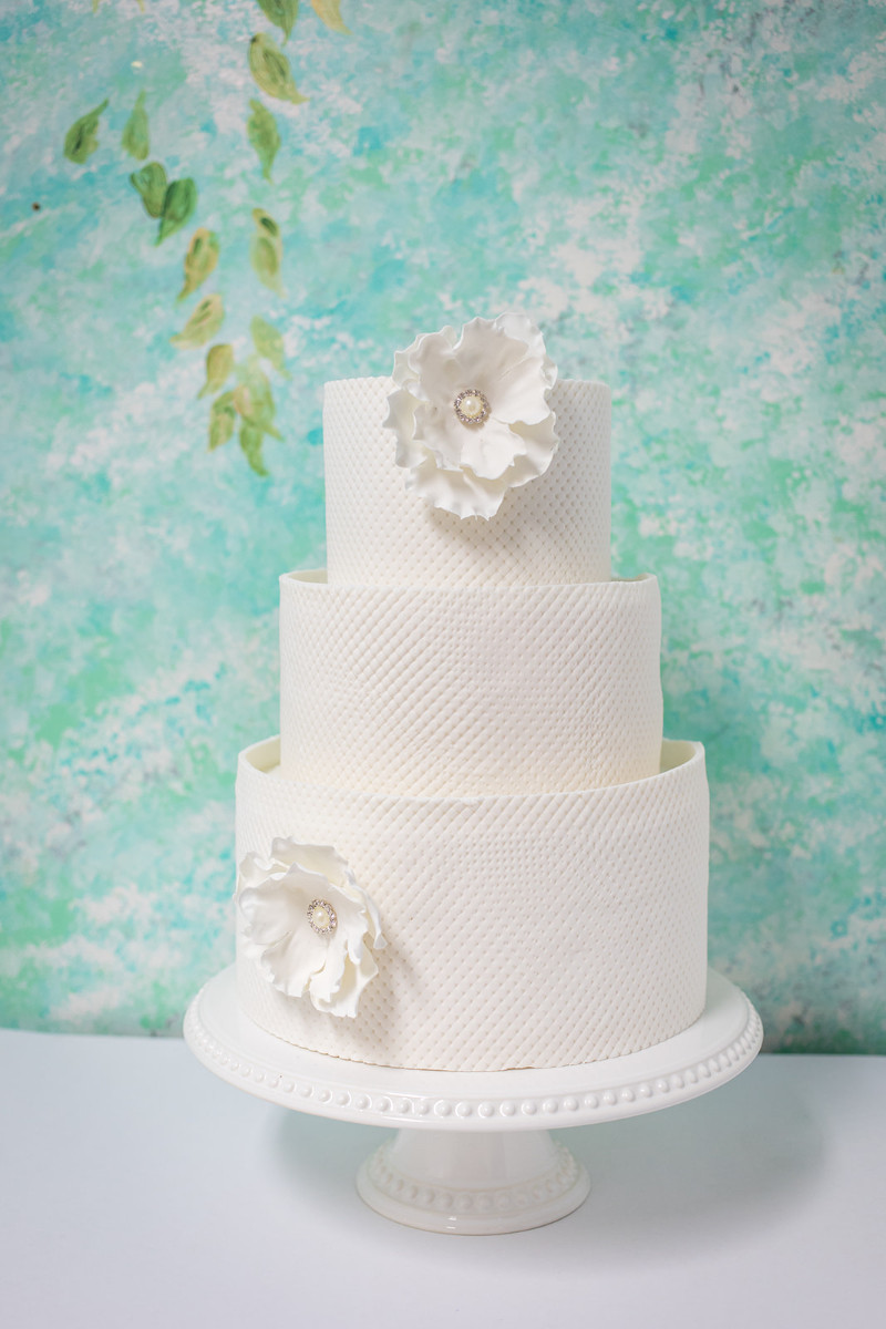 classic white wedding cake with white flowers