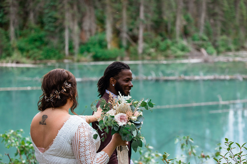 Rocky Mountain elopement first look wedding photos where bride is behind groom