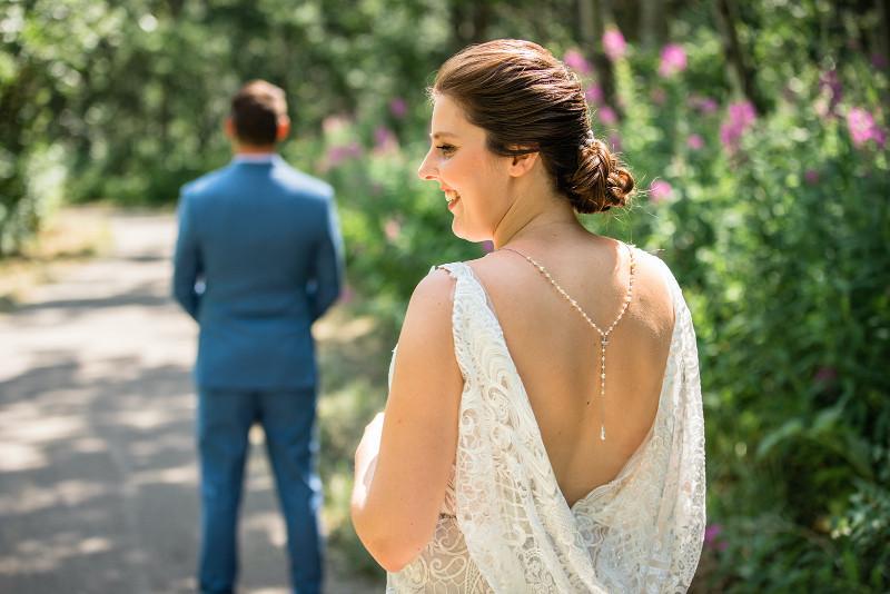 bride approaching groom before first look wedding photos in Calgary