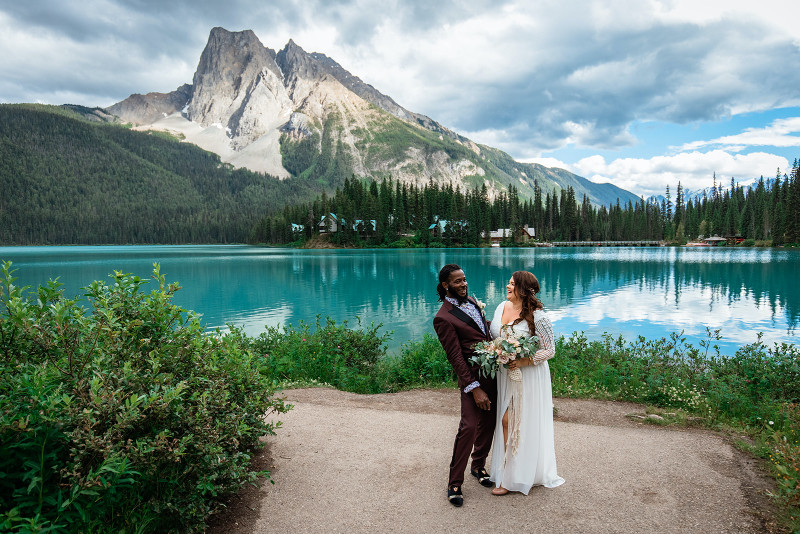stunning turquoise mountain lake in the Rocky Mountains for bride and groom wedding photos