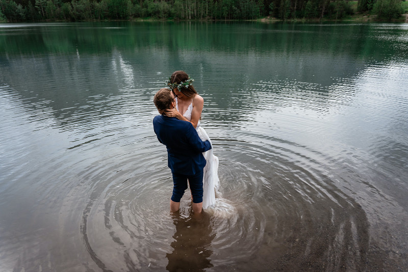 Bride and Groom in Rocky Mountains in the Lake