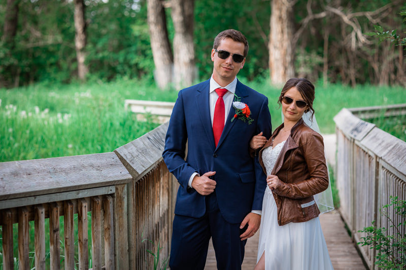 Bride and groom photos with leather jacket and aviators