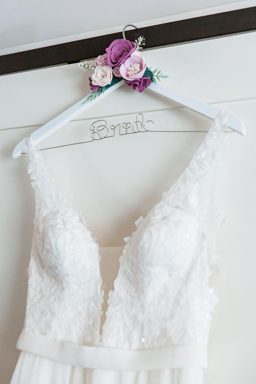 Calgary wedding dress on Bride Hanger with Flowers