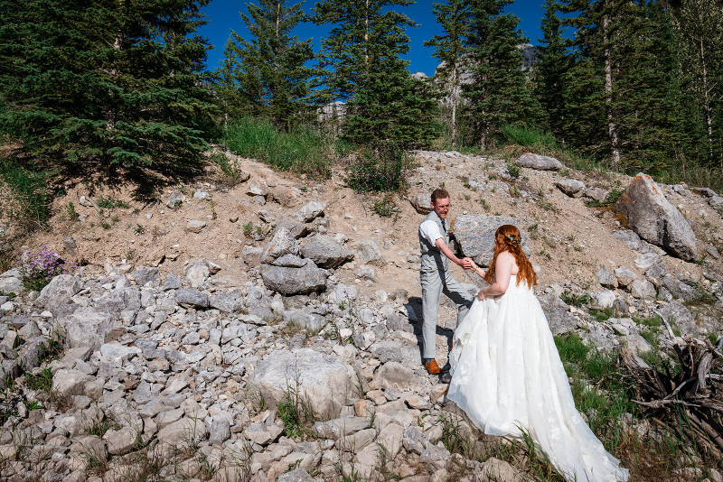 Bride and groom climb mountain for their adventure elopement