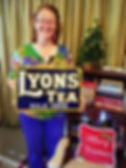 A very Happy Christmas for Jane with her Lyons' Tea sign.