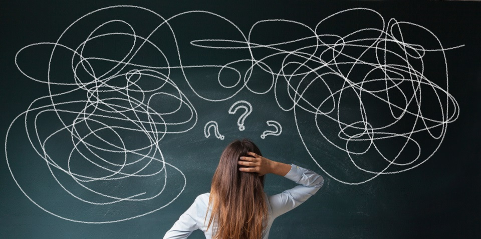 Confused teacher looking at blackboard