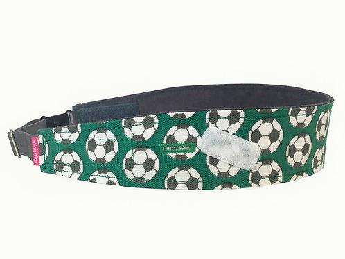 Footballs on Green Background