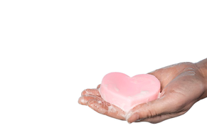 person-holding-heart-shaped-soap-with-co
