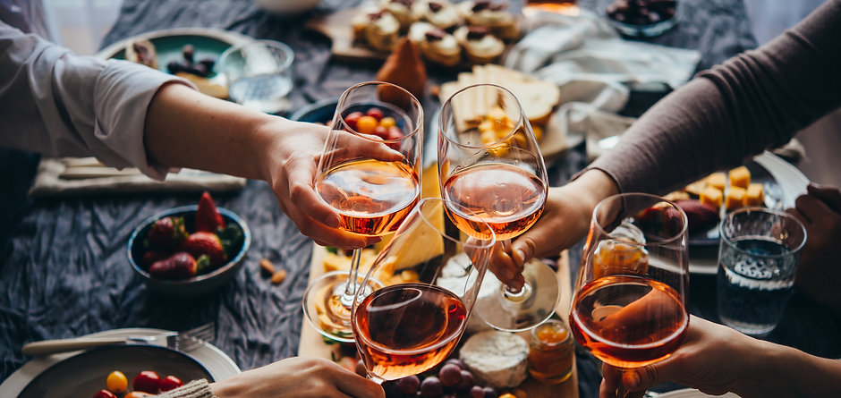 Glasses of rose wine seen during a frien