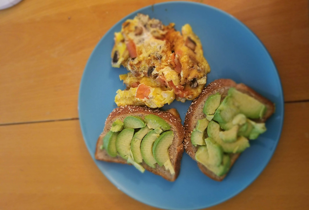 scrambled eggs with toast and avocado