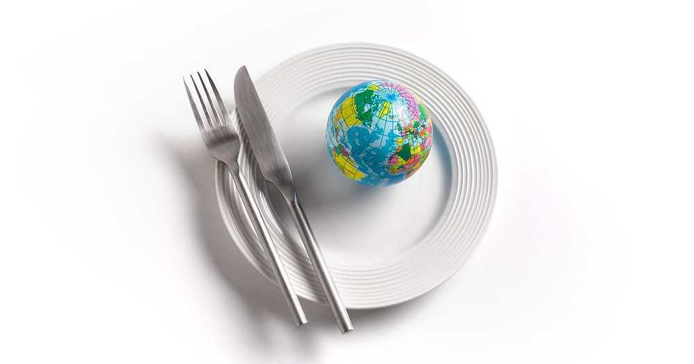 knife and fork and world on a plate